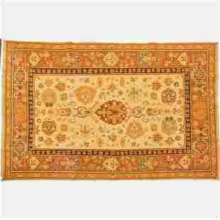 A Sino Persian Tabriz Wool Rug, 21st Century.