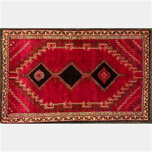 A Persian Qashqai Shiraz Wool Rug, 20th Century.