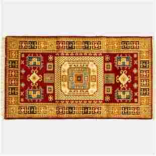 An Indo Caucasian Kazak Wool Rug, 21st Century.