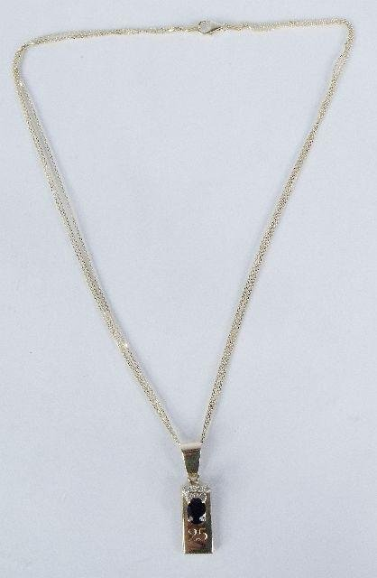 6: A 14 kt Yellow Gold, Diamond and Sapphire Drop Penda