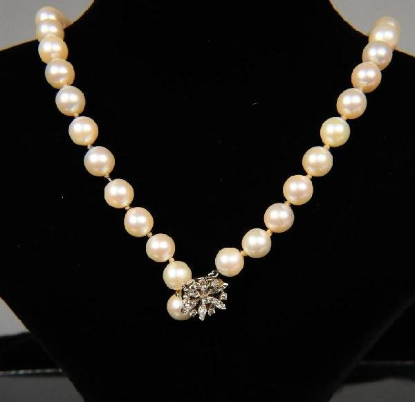 12: A Diamond and Pearl Single Strand Necklace,