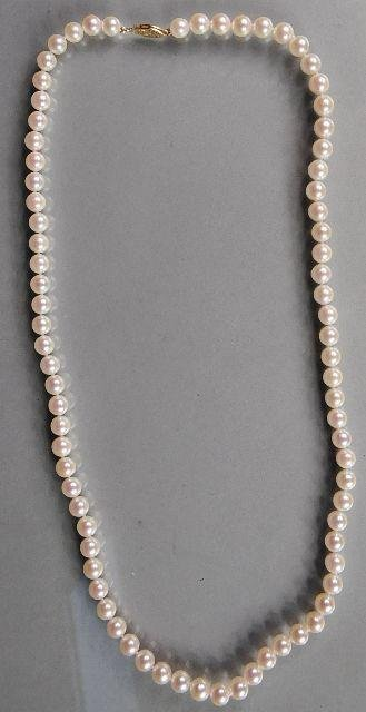 13: A Single Strand Akoya Pearl Necklace,