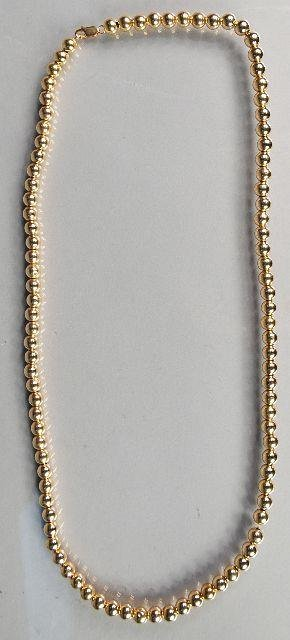 16: A 14 kt Yellow Gold Beaded Necklace,
