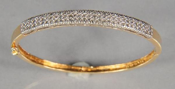 21: A 14 kt Yellow Gold and Diamond Melee Bracelet.