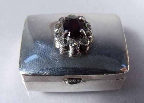 152: A Sterling Silver and Garnet Pillbox.