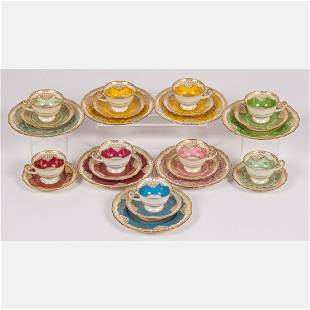 A Set of Nine Hutschenreuther Porcelain Cups and