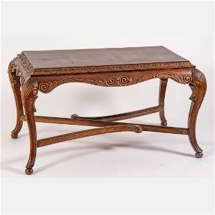 A Spanish Colonial Style Carved Tropical Mahogany Low