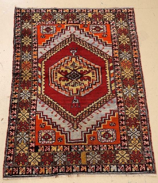 """An Antique Turkish Village Wool Rug, 3' 7"""" x 5' 5"""""""