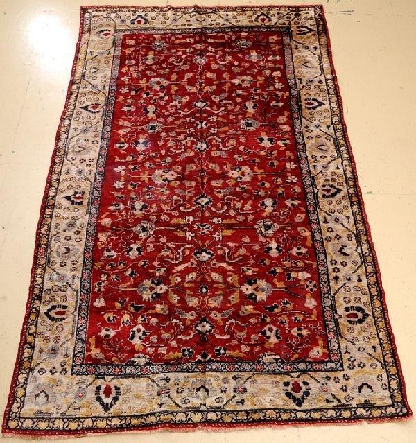 "An Antique Turkish Wool Rug, 5' 9"" x 9' 10"""