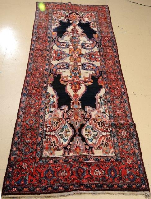 "An Antique Persian Gallery Bakhtiari Wool Rug, 4' 11"" x 13' 6"""