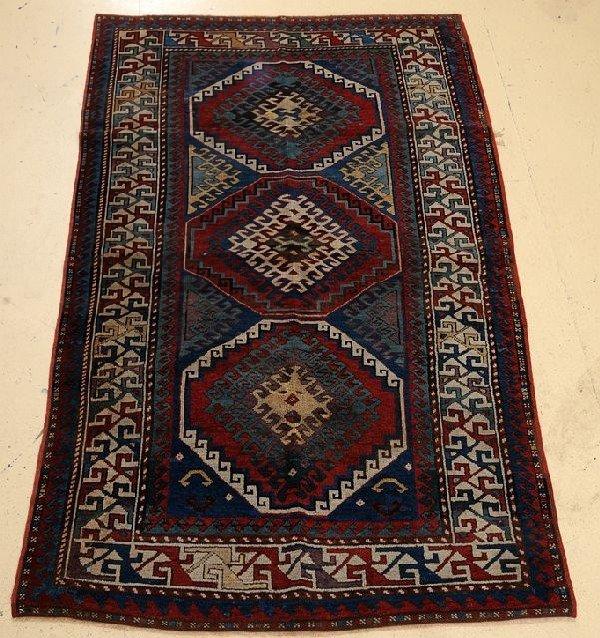 """An Antique Kazak Caucasian Wool Rug, 4' 4"""" x 7' 2"""""""