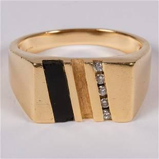 A 14kt Yellow Gold Onyx Diamond Ring