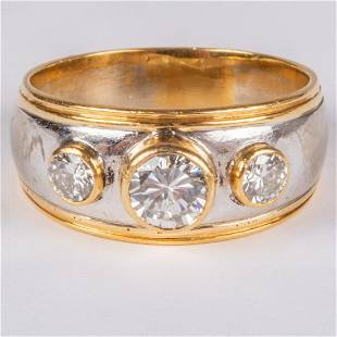 An 18kt Yellow Gold and White Diamond Ring