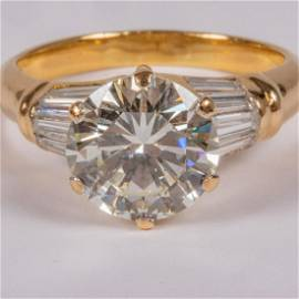 An 18kt. Yellow Gold and Diamond Ring