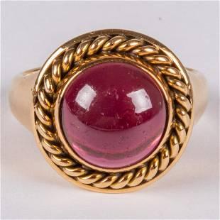 An 18kt Yellow Gold and Garnet Ring
