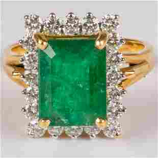 An 18kt Yellow and White Gold, Emerald and Diamond Ring