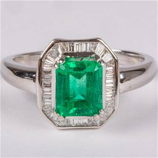 A 18kt White Gold, Emerald and Diamond Ring