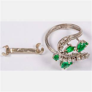 A 14kt White Gold Emerald and Diamond Ring