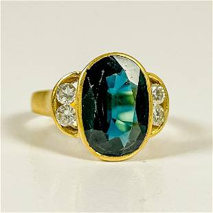 An 18kt Yellow Gold Topaz and Diamond Ring