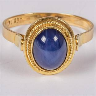 A 14kt Yellow Gold and Synthetic Star Sapphire Ring