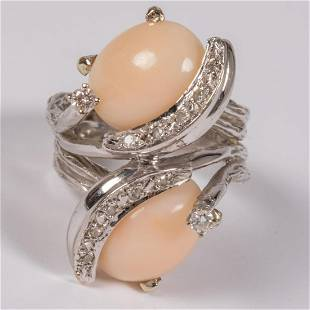 A 14kt White Gold Pink Coral and Diamond Ring