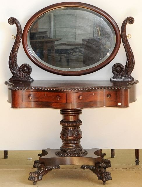 8: A Rococo Revival Carved Mahogany Mirrored Dressing T