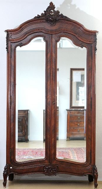 9: A Louis XV Style Carved Mahogany Mirrored Armoire, E