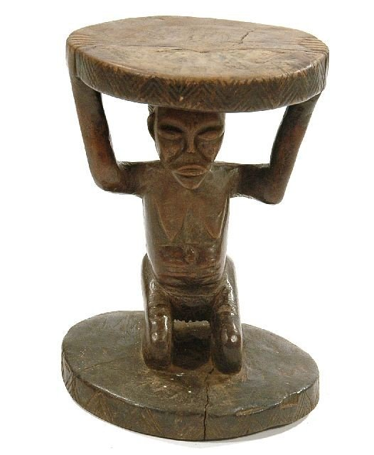 11: A Wood Caryatid Stool, Luba/Hema, Democratic Republ
