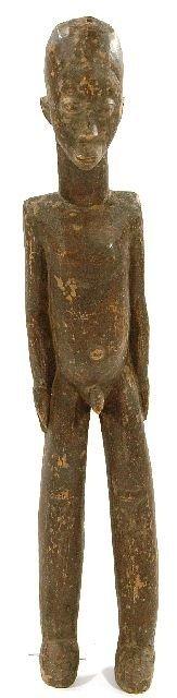 15: A Wood Standing Male Figure, Lobi, Burkina Faso.