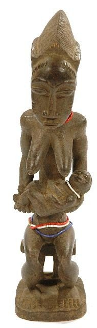 16: A Wood Seated Maternity Figure with Infant in Hands