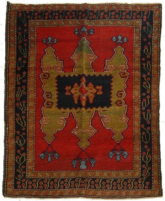 1: An Antique Lombalo Kazak Caucasian Wool Rug