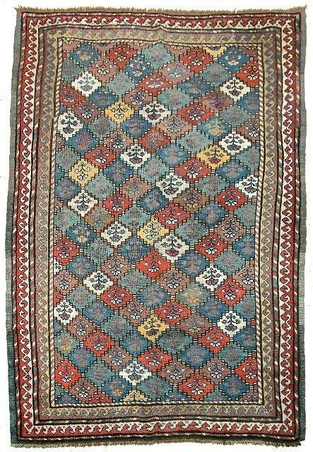 2: An Antique Kazak Kurd Caucasian Wool Rug