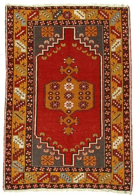 3: An Antique Turkish Ushak Wool Rug