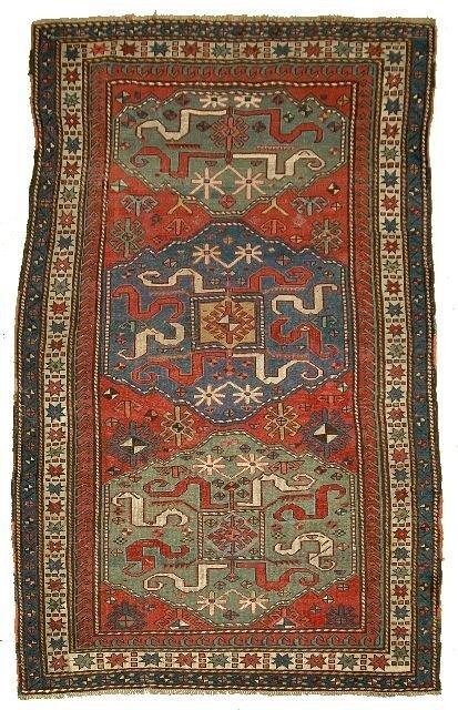5: An Antique Kazak Caucasian Wool Rug