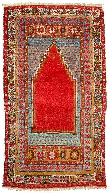 6: An Antique Turkish Mujar Wool Rug