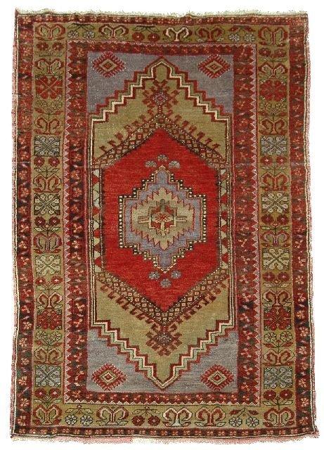 8: An Antique Turkish Wool Rug