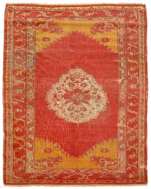 10: An Antique Turkish Ushak Wool Rug