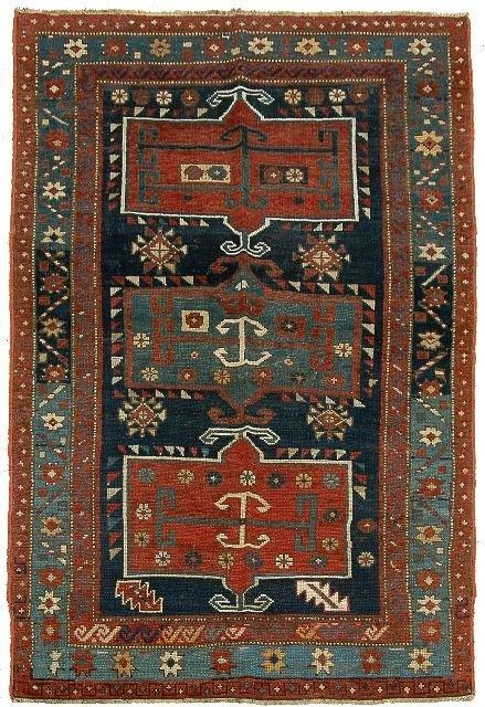 11: An Antique Kazak Caucasian Wool Rug