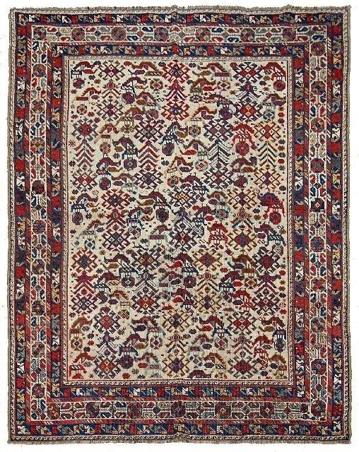 12: An Antique Persian Shiraz Bird Wool Rug