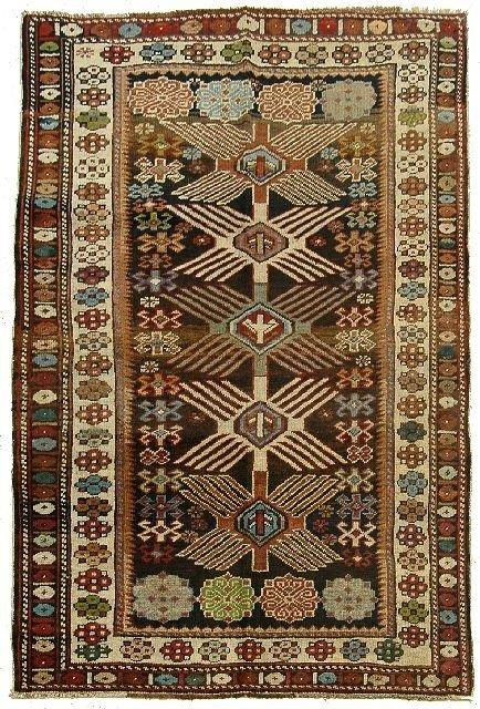 13: An Antique Kuba Caucasian Wool Rug