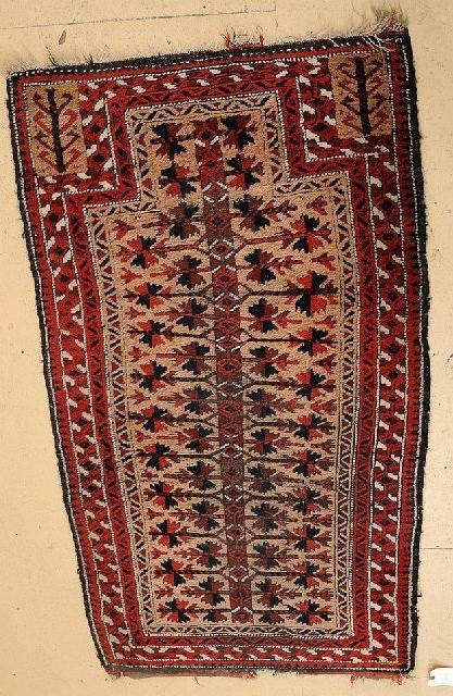 14: A Persian Baluch Wool Rug, 20th Century.
