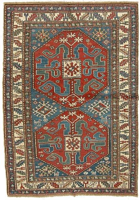 17: An Antique Cloud-band Kazak Caucasian Wool Rug