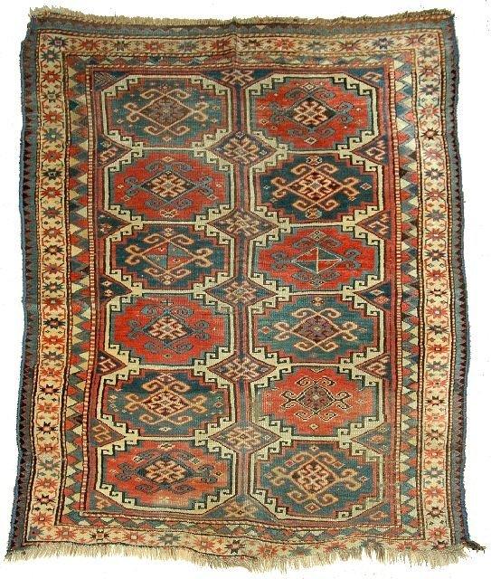 18: An Antique Kazak Caucasian Wool Rug