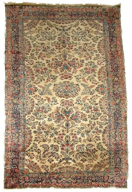 20: An Antique Persian Kirman Wool Rug