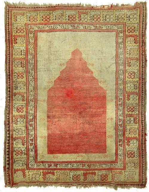24: An Antique Turkish Prayer Mujar Wool Rug