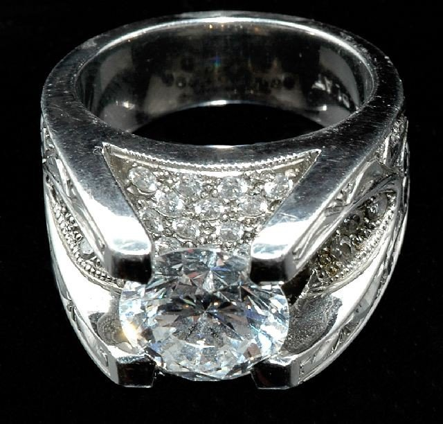 8: A Ladies Platinum and Diamond Ring,