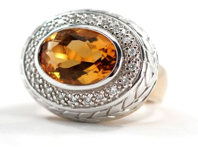 10: A 14 kt. Two Tone Citrine and Diamond Ring,
