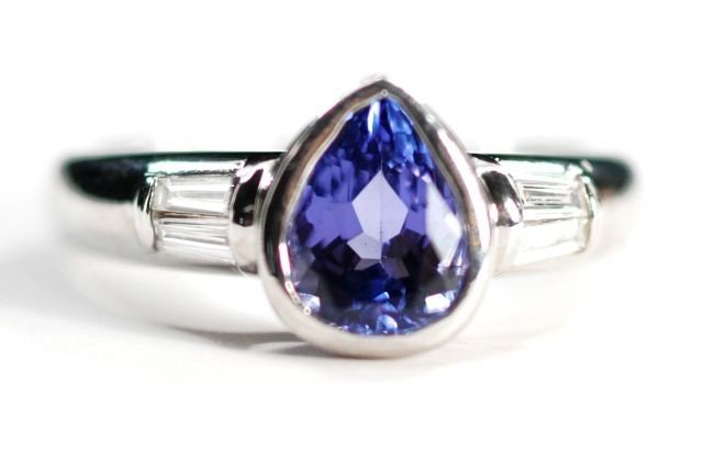24: A Platinum Tanzanite and Diamond Ring,