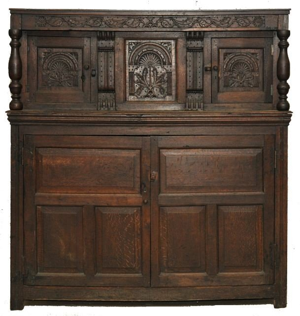 4: A Charles II Carved Oak Court Cupboard, 17th Century