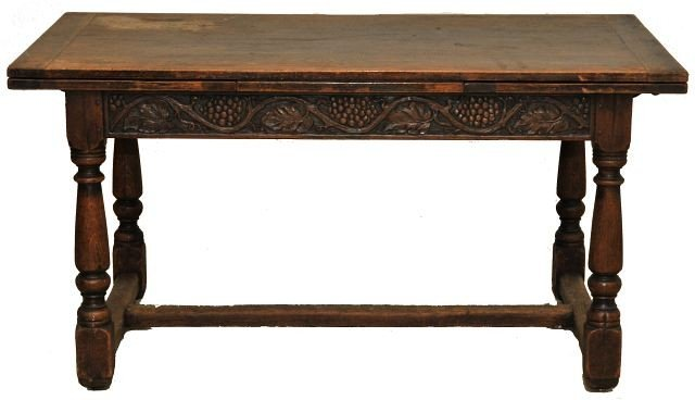5: A Rorimer and Brooks Carved Oak Trestle Table,